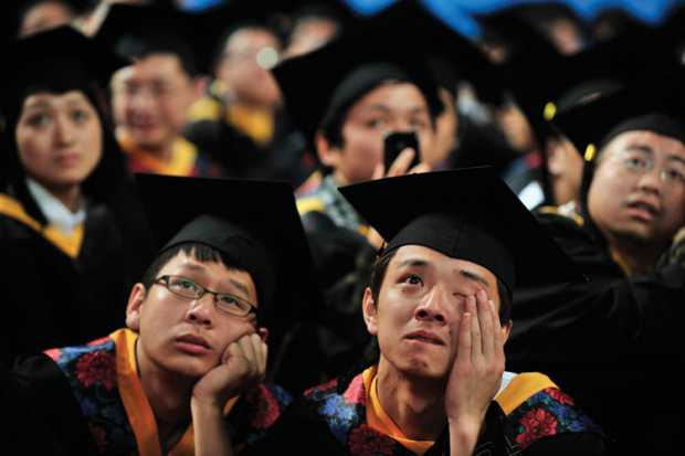 student_in_cap_and_gown_crying