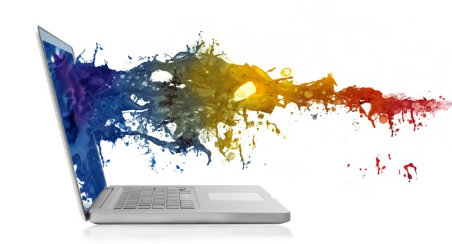 Wave of colored paint splashing out from a laptop screen